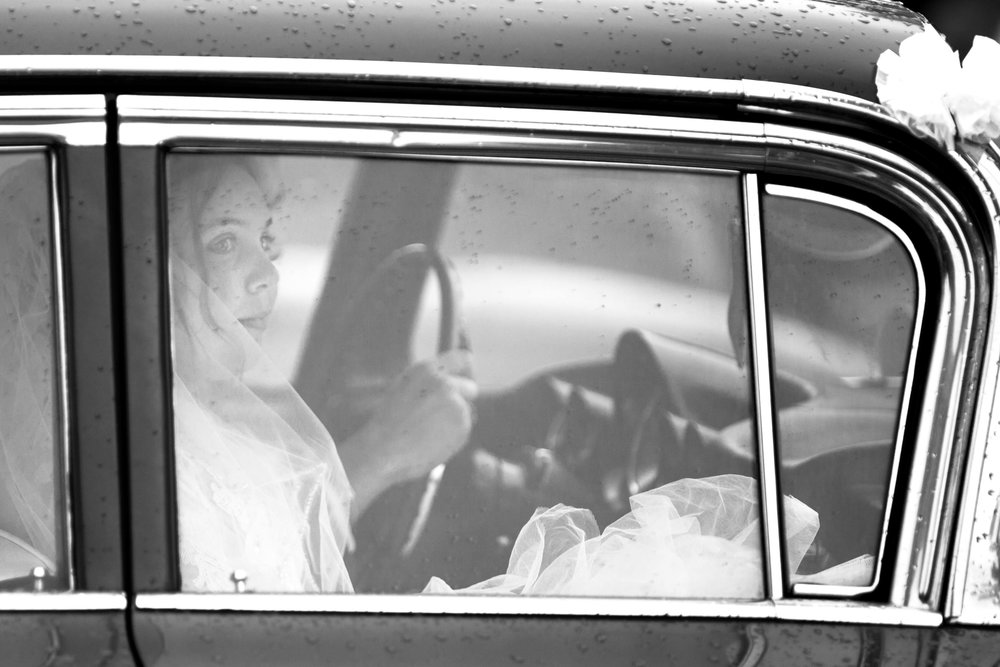 The couple drives away in a classic car, on their way to the reception, in Ottawa.