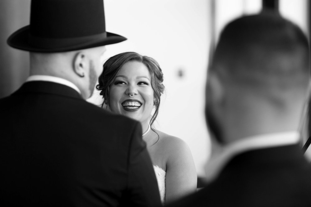 The bride laughs with joy as she looks at her husband, Lago Bar Grill wedding, Ottawa.