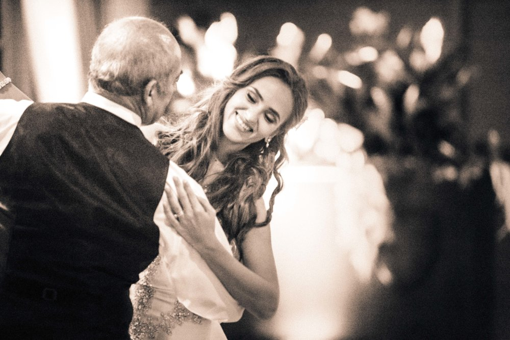 Copy of Bride dances with her father.