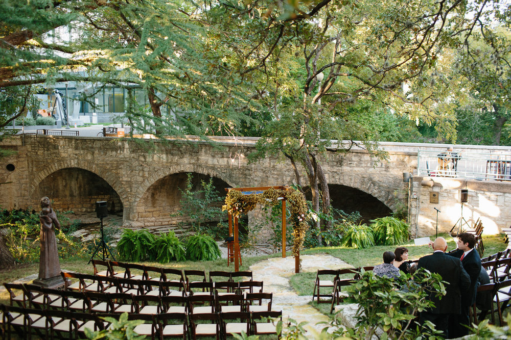 outdoor ceremony set-up by bridge in downtown Austin