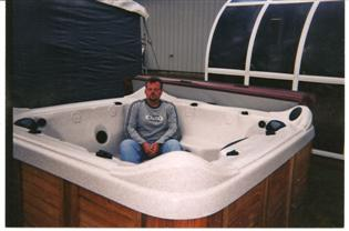 Josh at the County Fair showing how comfortable a Spa is