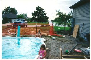 Ali (Josh & Kari's Daughter) fill up the pool 2003