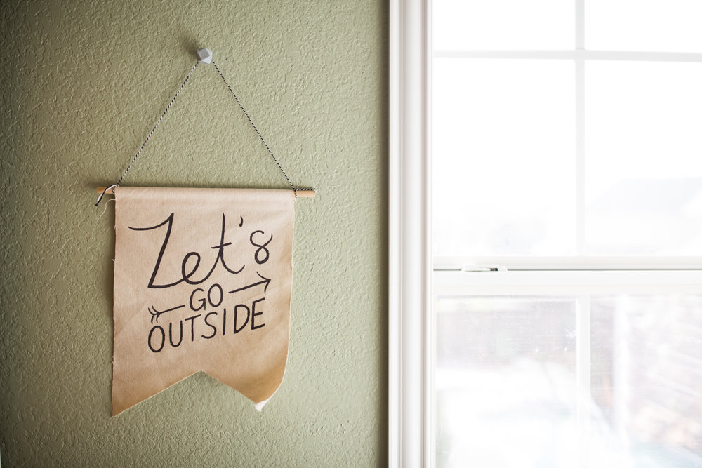 Hand-lettered canvas sign in boy outdoor theme nursery