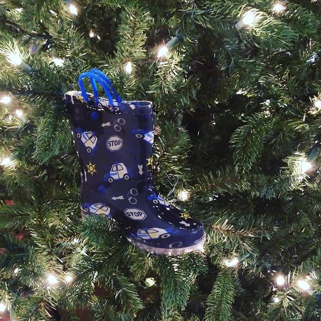 Stockings hung by the chimney with care or a rainboot placed in the tree with the purest intentions....this is my truth. 💙  #trimmingthetree #christmas #boymom