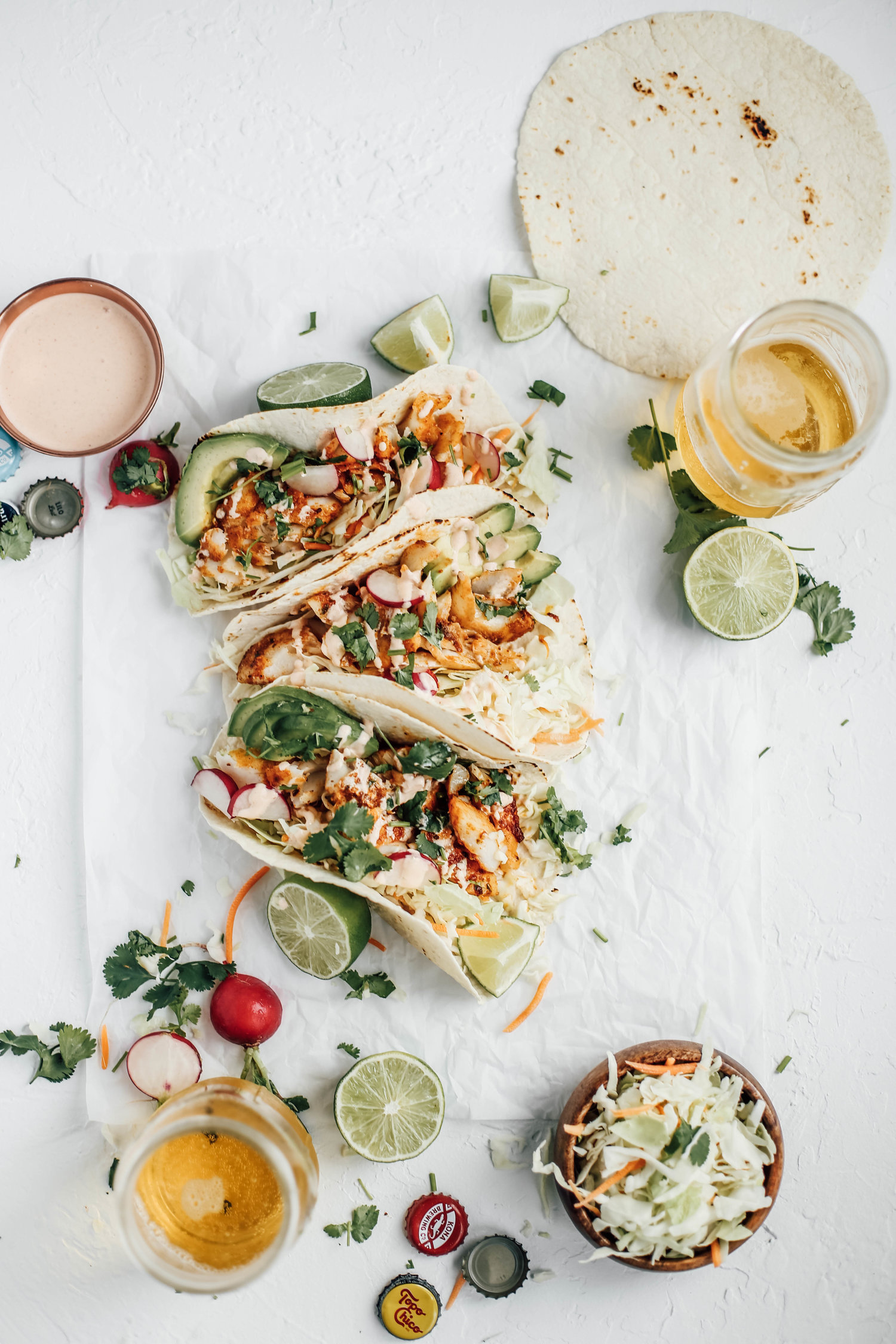 Blackened Cod Fish Tacos with Sriracha Lime Crema