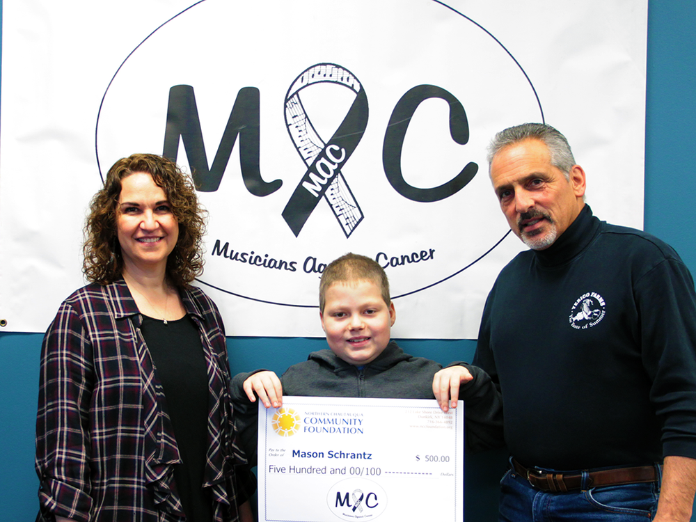 """We are overjoyed to present Mason Schrantz a check from our bands fund this Christmas! Mason is an amazing boy! We would like to thank all our donors and supporters! This is why our band and the fund was created. Thank you from all of us; John, Kristin, Nancy, Marty & Sandy!"""