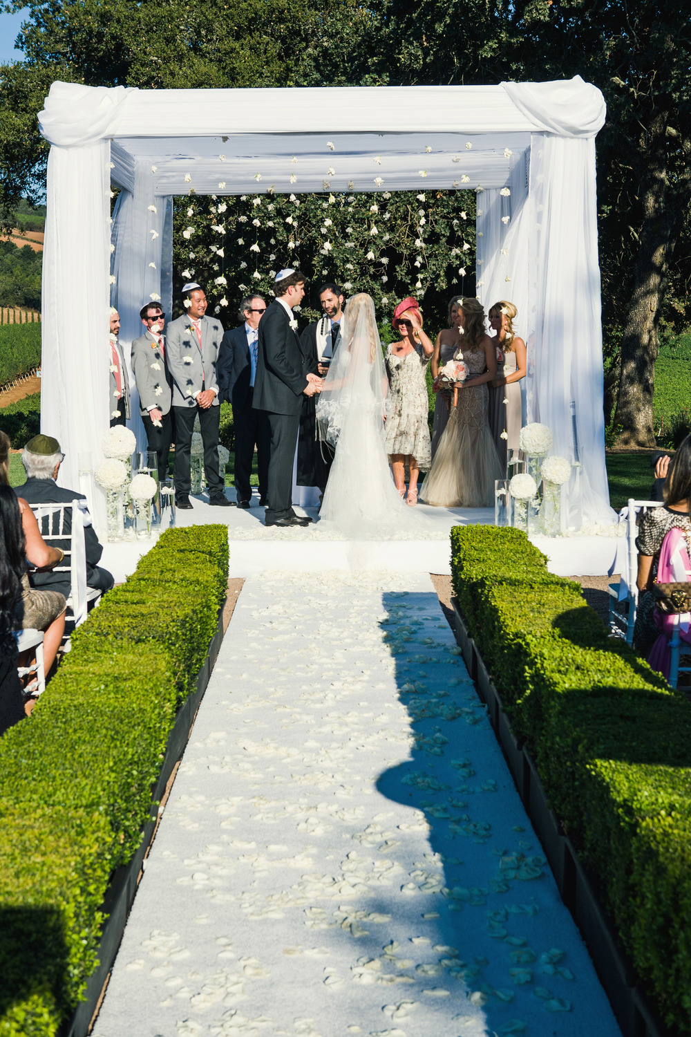 10. LS - ceremony aisle, white ceremony aisle+petals, hanging gardenias, hanging flwoers, pretty chuppah, vineyard ceremony.jpg