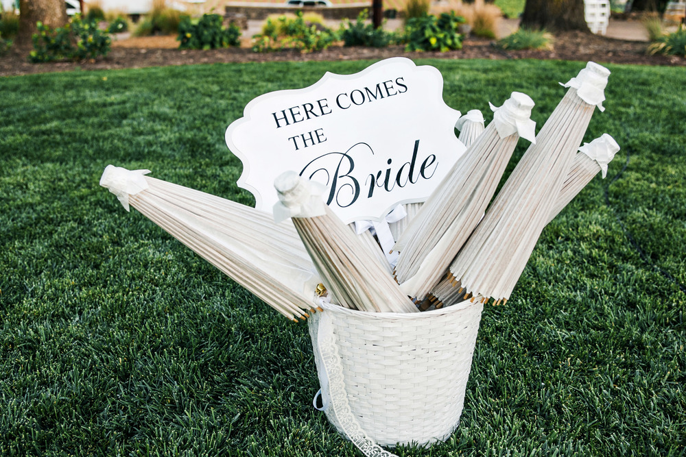 18. white wedding parasols, here comes teh bride sign, flower girl sign, white wedding ideas, summer wedding, vineyard ceremony, napa wedding.jpg