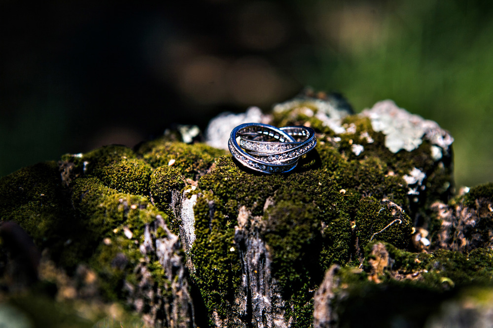 22. vineyard ceremony, napa wedding, artsy wedding ring shot, summer wedding, diamond triple band ring.jpg