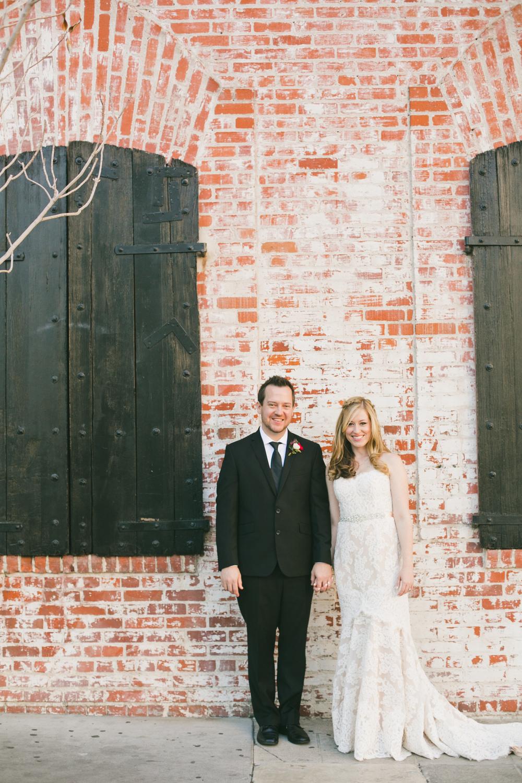 012 bride and groom + brick.JPG