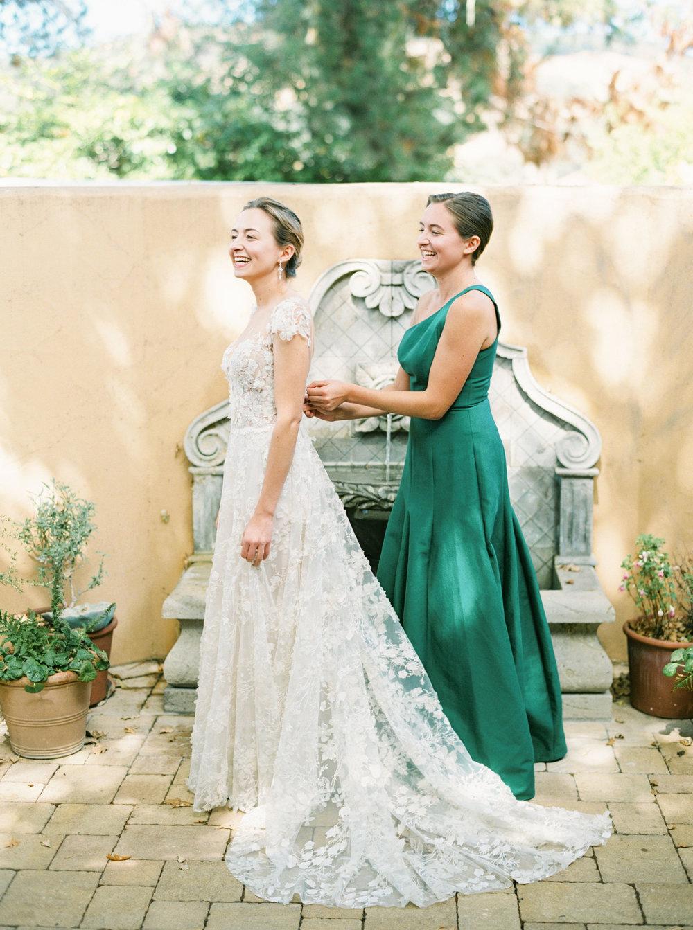 21. Bride Putting on Dress.jpg