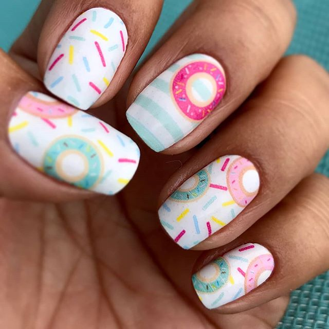 "You deserve something special! ""Treat Yourself"" nails feature colorful doughnuts and pastel colors - the perfect sweet treat. (📷: @gonzy253)"