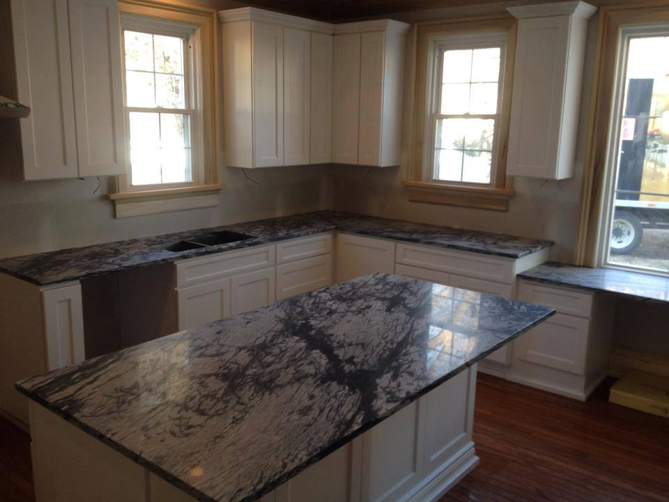 Creative Surfaces on stainless steel countertops kansas city, concrete countertops kansas city, recycled glass countertops kansas city, granite countertops kansas city, quartz countertops kansas city,