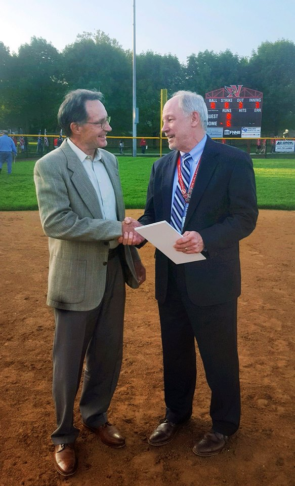 May 22, 2018   Bob Callaghan, superintendent of the Newton Community School District and Paul Koester, president of Koester Construction shake hands at the Newton Softball Field Dedication Monday night. While this marks the first professional project the pair have completed, Bob and Paul have worked together in the past - the distant past! 45 years ago, Bob and Paul were high school classmates.  The two reunited at a high school once again last night to celebrate the completion of the Newton Softball Complex and dedicate the field! This Koester Construction project included the softball field, a storage shed, two dugouts, and bleachers for Newton Cardinal fans!