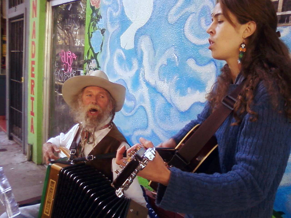 Busking with my friend J. Michael Combs. Photo: Huracán Gomez