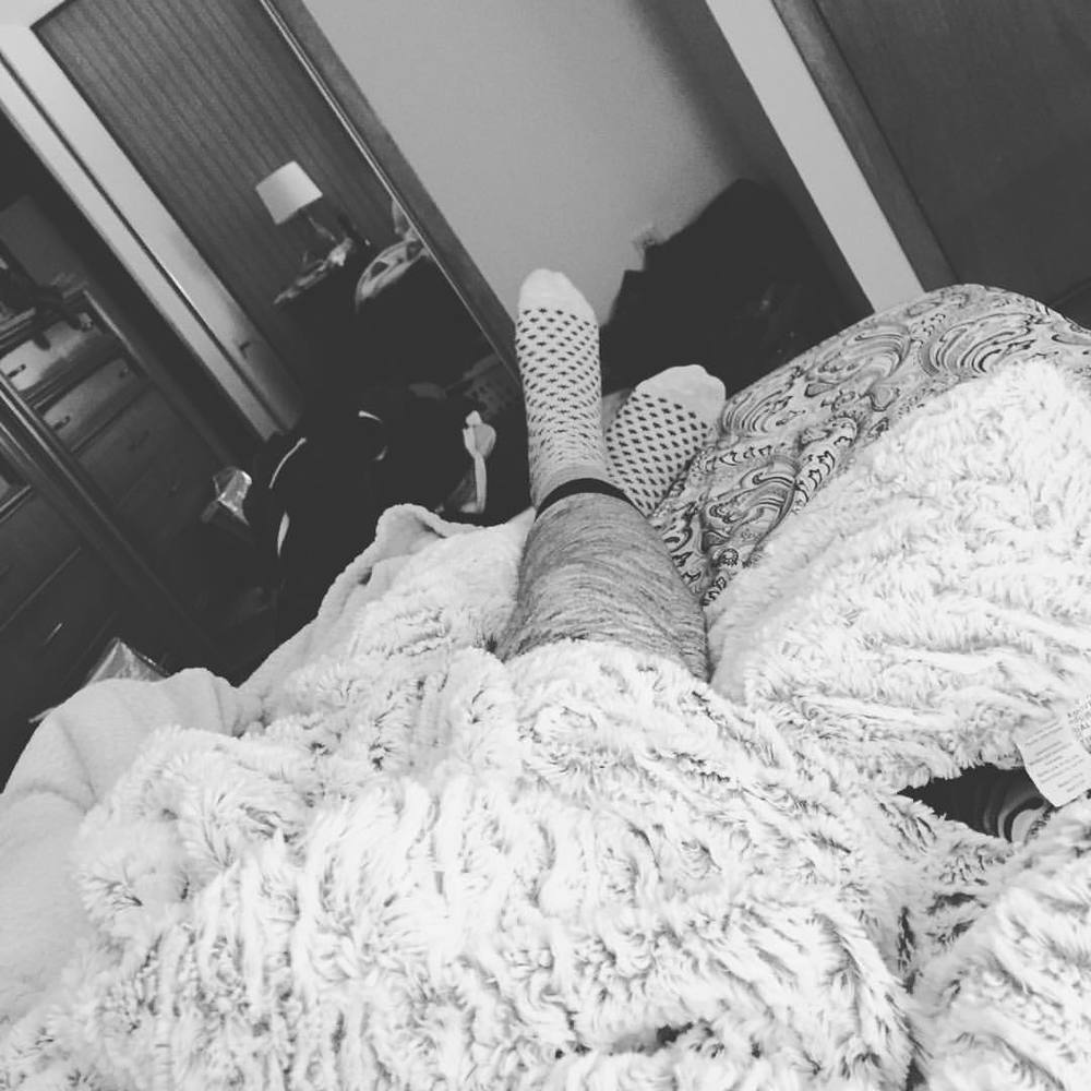 relax bed comfy cozy blankets socks feet love.jpg