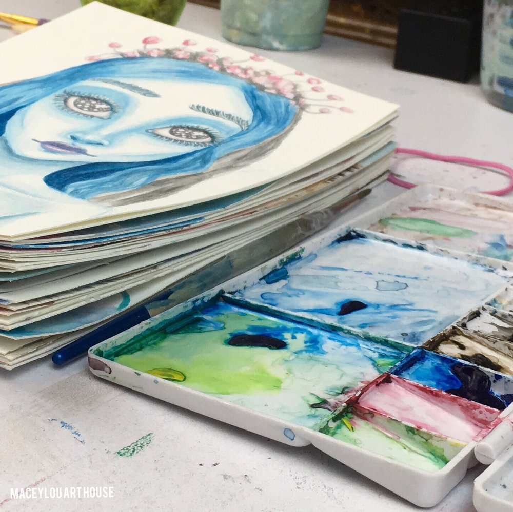 watercolor artworks and a paint palette