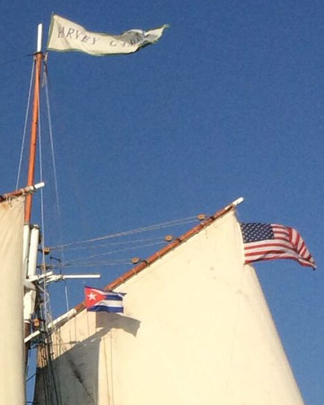 By maritime protocol, a visiting ship flies her own flag, as well as the flag of the nation visited.  When calling on Cuba, the  Harvey Gamage  flies both the U.S. and Cuban flags.