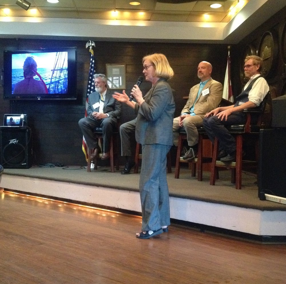 U.S. Rep. Chellie Pingree of ME (far right) recalls her own recent visit to Cuba. On stools (L-R): boat owner Phin Sprague, American University Professor Bill Leogrande (obscured), Ocean Passages President Greg Belanger and Harvey Gamage Capt. Christopher Flansburg