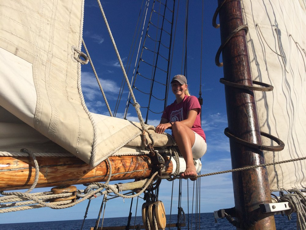 Deckhand Meghan flaking the foresail before the swim call