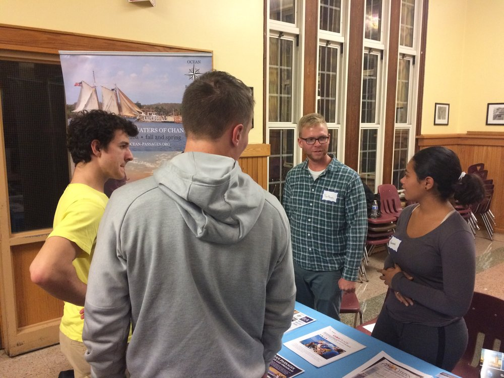 Ocean Passages Program Director Nathan Hesse (2nd from right) is joined by former student Hannah Seda (right) at the Scarsdale, NY USA Gap Year Fair