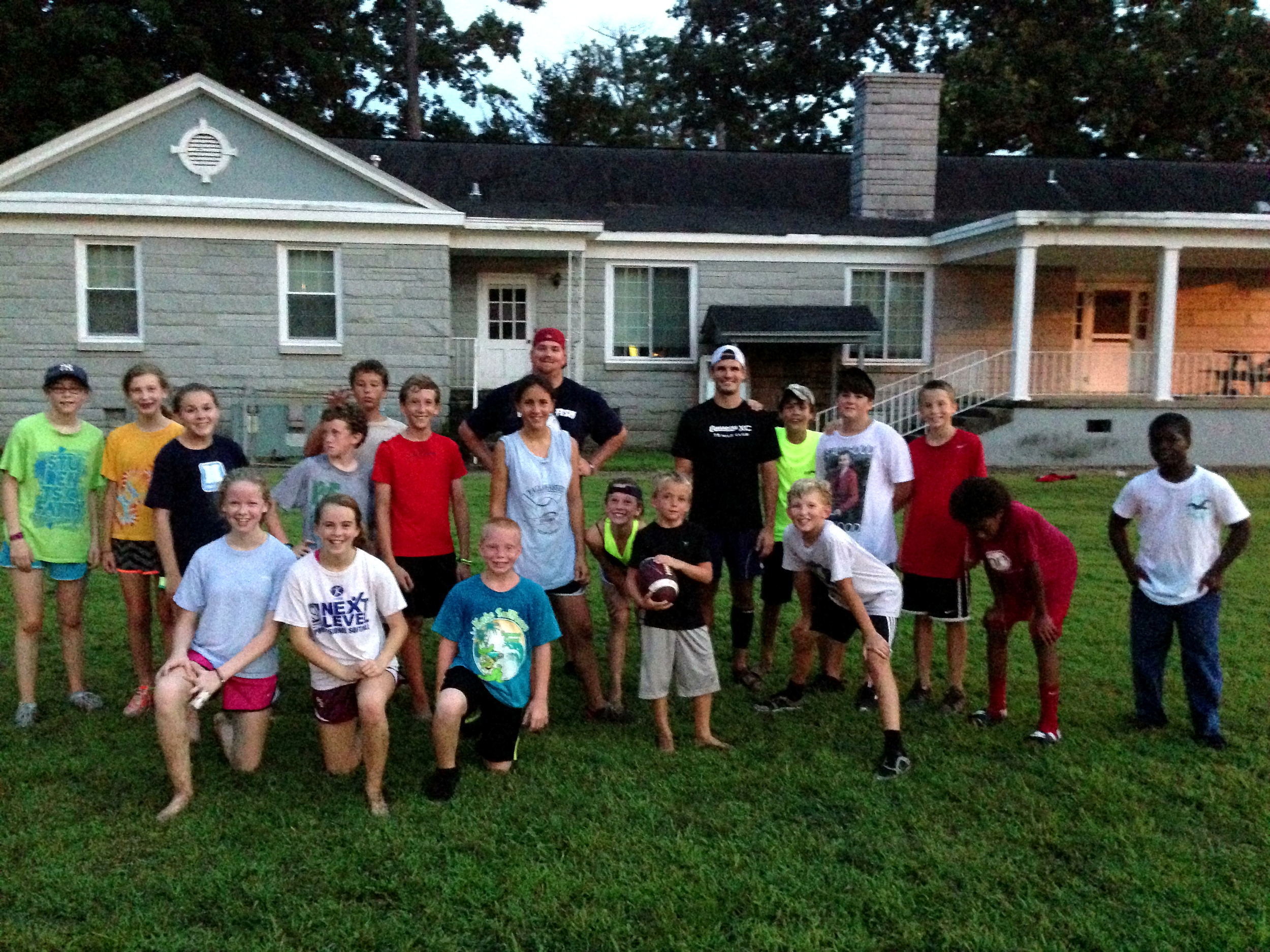 Some of our group with a few of the boys who joined in playing football at night.