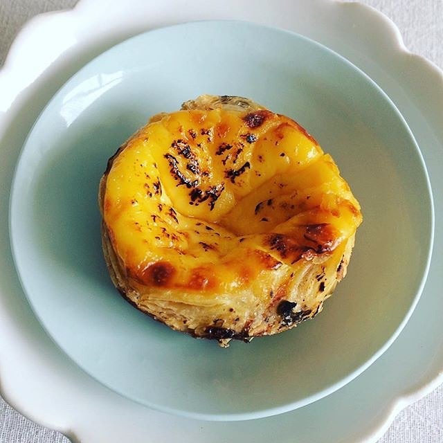 The mighty Portuguese Tart. Simply an eggy, custardy filling inside a flaky pastry casing. Best eaten fresh out of the oven when they hit the counter each morning! 📷: @julieleclercnz