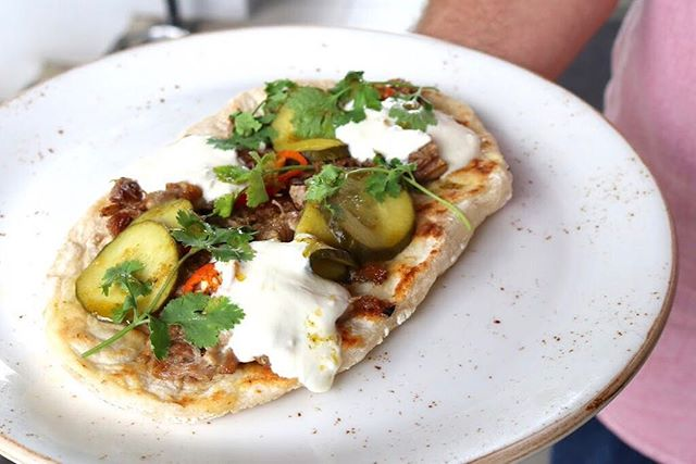 Our lamb shoulder flatbread with cucumber, chili and yogurt tastes as good as it looks! #richmondrdcafe #hipgrouplife