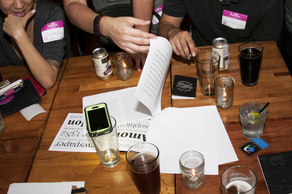 Attendees at the first TypeThursday event discuss a project up for critique. August 6, 2015