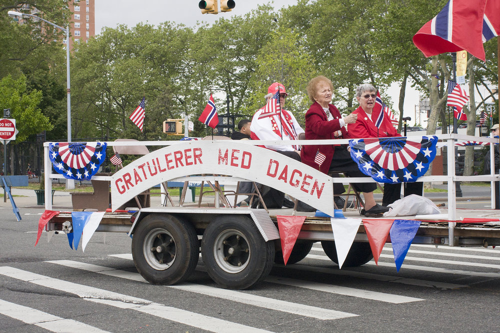 """Gratulerer med dagen"" is the greeting exchanged on Norwegian National Day. It translates to ""congratulations with the day."" This greeting is also traditionally exchanged on birthdays and new year's eve."