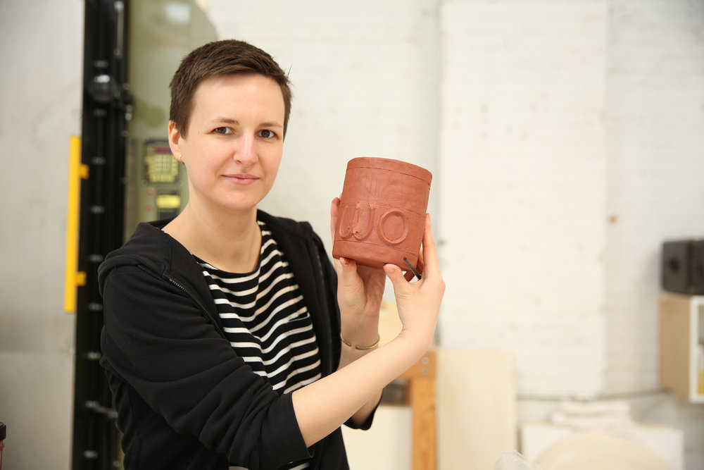 "Karolina has applied strips of clay to create a 3-D relief-like effect for the lettering on this mug. It will say ""Nasty Woman;"" a term that was used by Trump to describe Hillary Clinton during the third Presidential debate in 2016. It instantly became a worldwide meme."