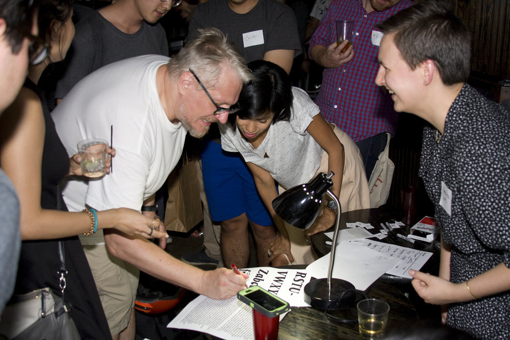 Hannes (left) writes comments on Shayma's (center) typeface at the second TypeThursday meet up at Trophy Bar in Brooklyn. September, 2015