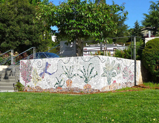 Students, parents, neighbors and artists pitch in to create this gorgeous mosaic at Redwood Heights Elementary School.