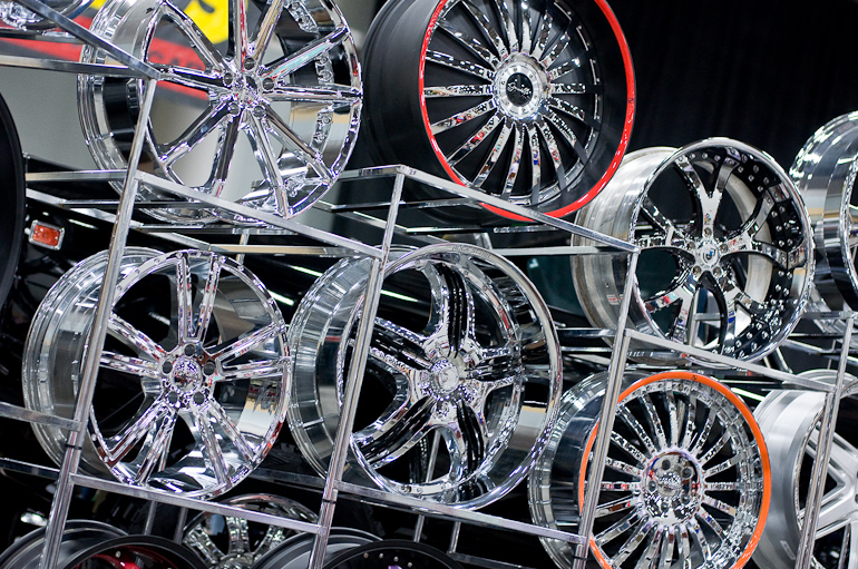 A wall of rims, taken at the auto show in Des Moines, Iowa.