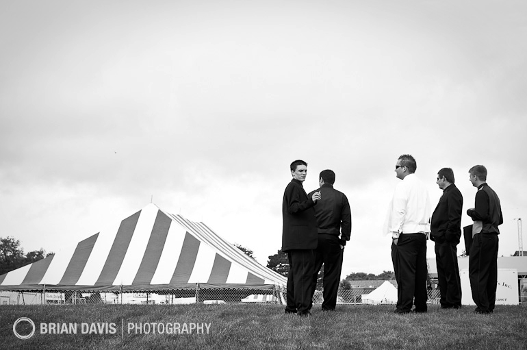 Groomsmen gathering on a hilltop awaiting the wedding at the Country Bash Festival in Des Moines, Iowa