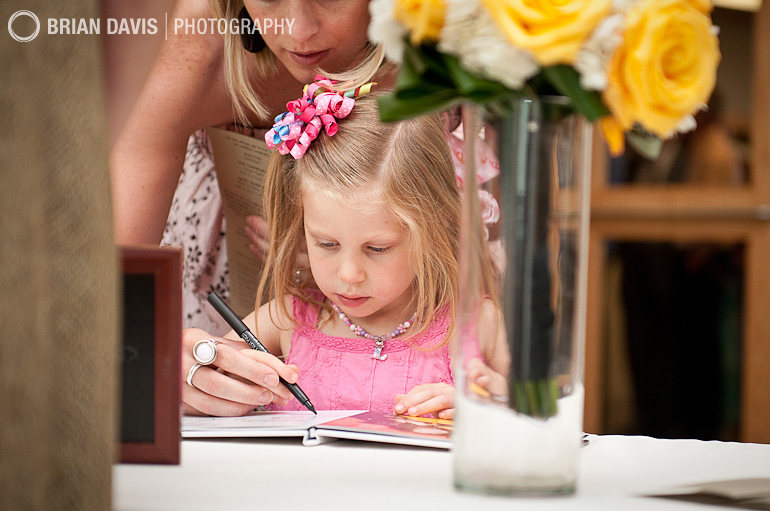 Little girl signing the guest book