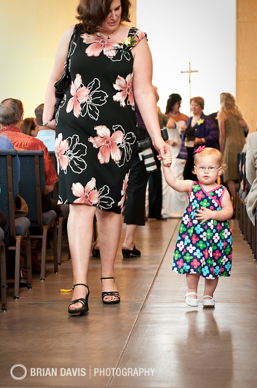 Cute little toddler walking down the aisle