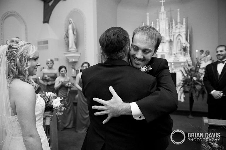 Jordan hugging Erica's father
