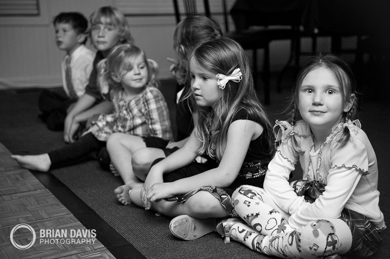 Kids sitting during the first dance