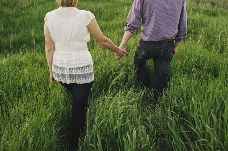 Bryan leading Jill through a field of tall grass in Des Moines, Iowa