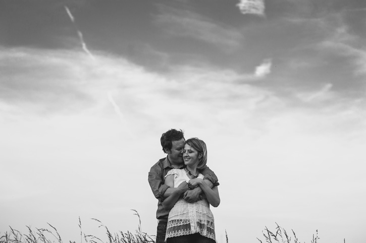 Bryan wrapping his arms around Jill during a Des Moines, Iowa Engagement Session.