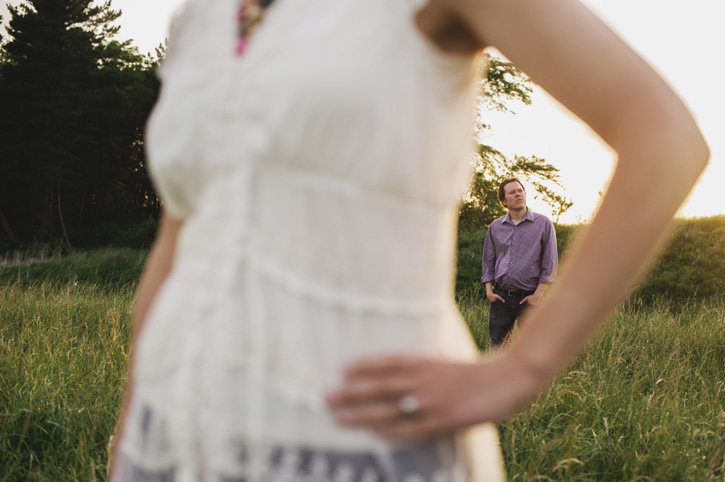 Bryan and Jill hanging out in a field during their Des Moines, Iowa Engagement Session