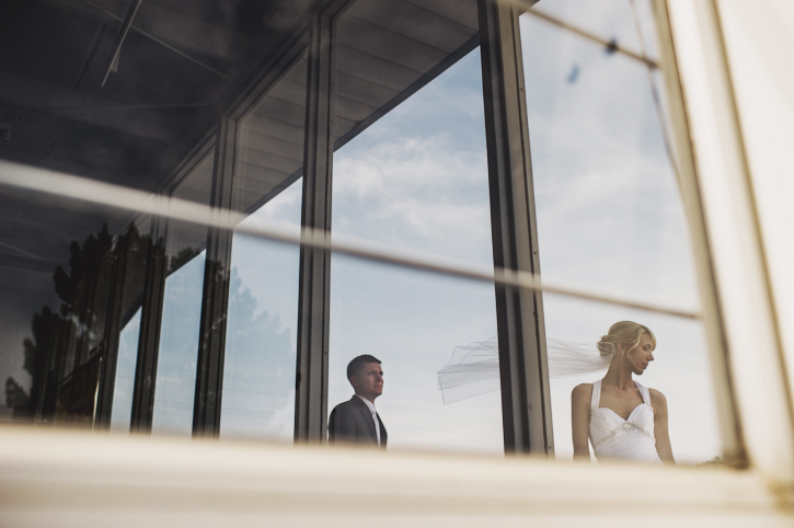 Nina and Tanner strike a dramatic pose through the windows of a car dealership in Des Moines, Iowa.