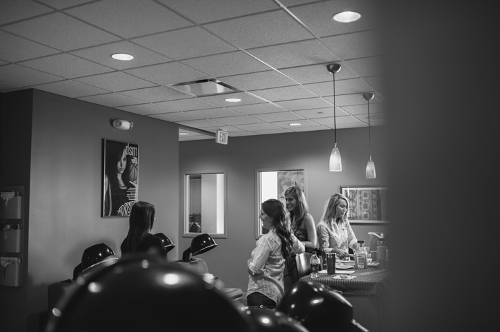 Laura and her bridesmaids laughing and having a good time at Estilo Salon in West Des Moines