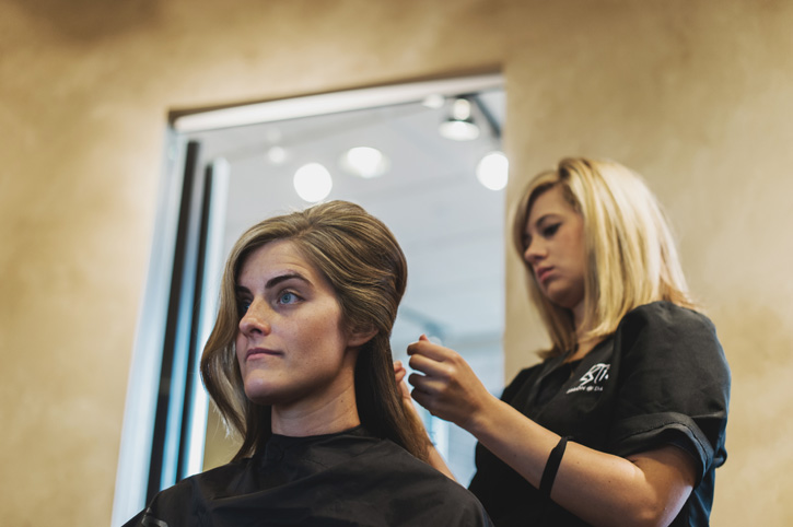 Laura getting the finishing touches on her hair at Estilo Salon in West Des Moines, Iowa