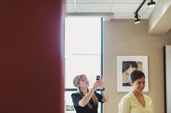 The hairstylist photographing the hairstyles at Estilo Salon in West Des Moines, Iowa