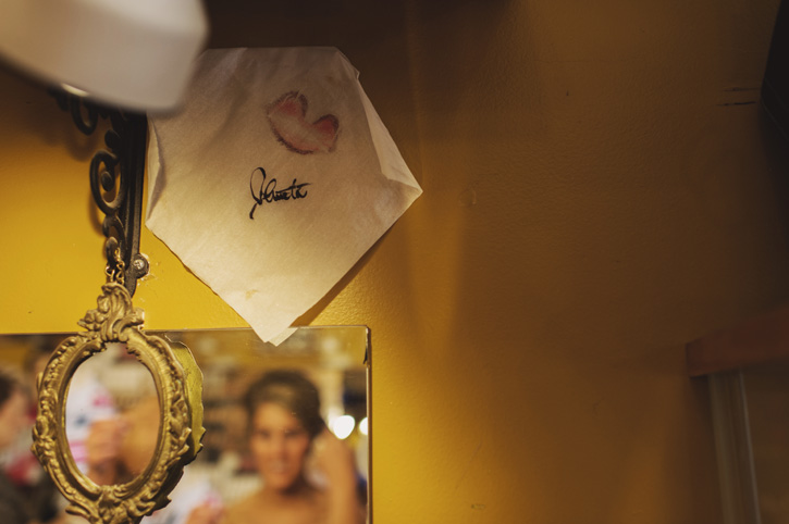 A napkin hanging on the wall with lipstick on it at Vanity and Glamour in the East Village of Des Moines, Iowa