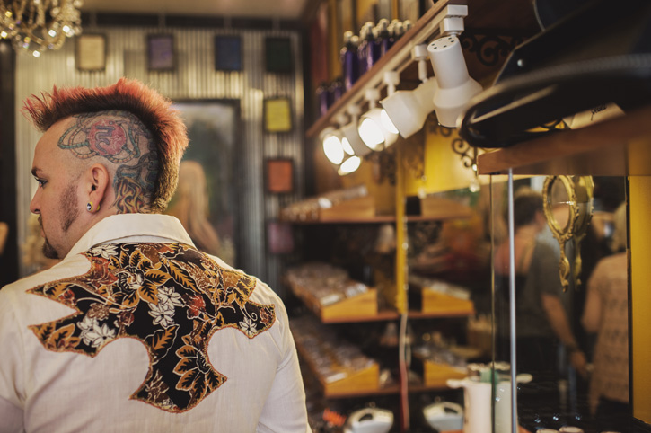 A closer look at the makeup artists mohawk and wild shirt at Vanity and Glamour in the East Village of Des Moines, Iowa