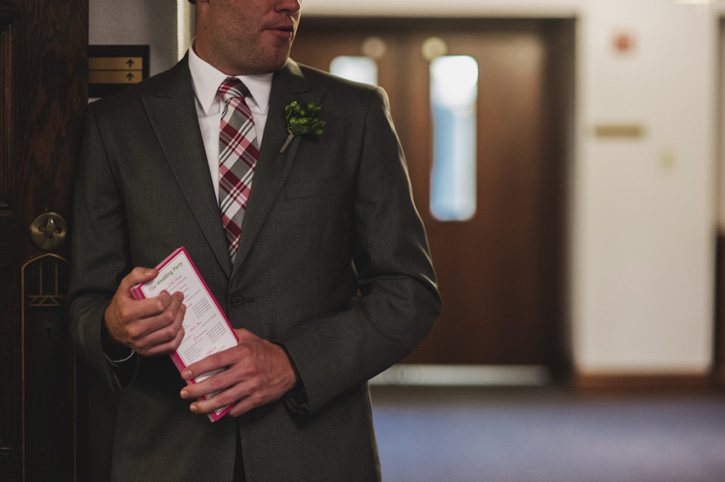 A groomsmen handing out programs at their church in Des Moines, Iowa