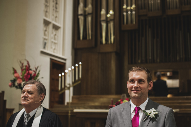 Ryan's face when he sees Laura coming down the aisle with her father at their church in Des Moines, Iowa